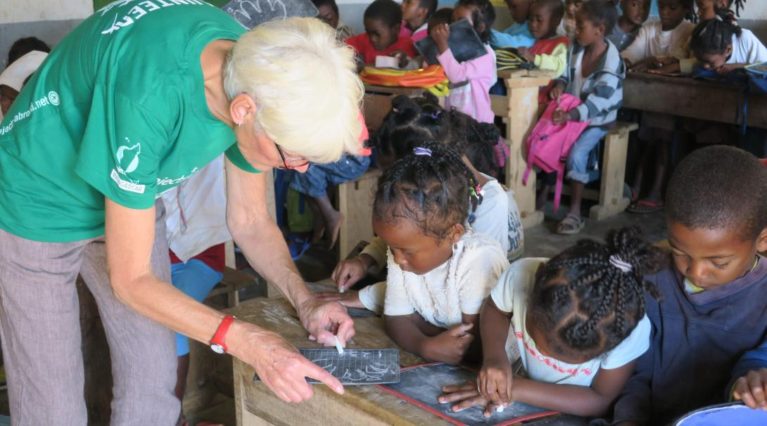 A Projects Abroad volunteer runs literacy activities in a school in Madagascar for children.